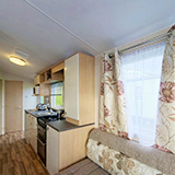 Take a virtual tour of our 2-star caravan